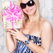 Beautiful young lady with a present — Stock Photo #11171436
