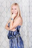 Lovely blond girl in a blue dress — Stock Photo