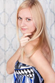 Young elegant blond model in a dress — Stock Photo