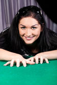 Smiling brunette model at a pool table — Stock Photo