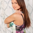 Cute young brunette girl in a dress — Stockfoto
