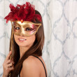 Stock Photo: Pretty young girl with a mask