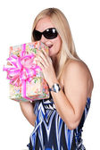 Pretty blond girl with a gift — Stock Photo