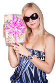 Gorgeous blond lady in a blue dress with a present — Stock Photo