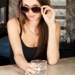 Stock Photo: Stylish brunette with glass in bar