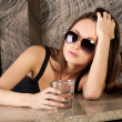 Stock Photo: Attractive brunette with glass in bar