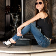 Seductive brunette in sun glasses on bar table — Stok Fotoğraf #11587390
