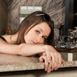 Beautiful brunette girl in the bar — Stock Photo