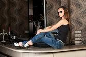 Stylish fashion model in a sun glasses — Stock Photo