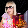 Cute blond girl with presents — Stock Photo