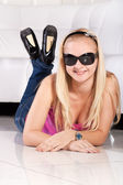 Smiling blond young girl in sun glasses — Stock Photo