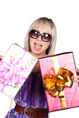 Cheerful blond girl with gifts — Stock Photo