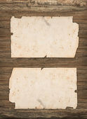 Crumpled old papers on a dark wooden background — Stock Photo