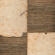 Faded old papers on a wooden background - Stockfoto