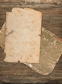 Weathered crumpled papers on a wooden background — Stock Photo