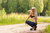 Gorgeous young blond model in sun glasses — Stock Photo