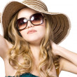 Stock Photo: Beautiful model in hat with glasses