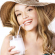 Young beautiful smiling blond woman with milkshake — Stock Photo