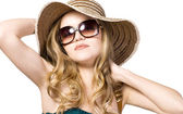 Beautiful model in hat with glasses — Stock Photo