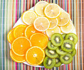 Tropical fruit on plate on colorful background — 图库照片