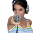 Attractive Brunette with Headphones and a Microphone (3) — Stock Photo #10832126