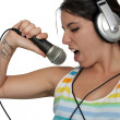 Attractive Brunette with Headphones and a Microphone (4) — Stock Photo