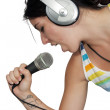 Attractive Brunette with Headphones and a Microphone (5) — Stock Photo #10832192