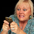 Mature Blonde Woman with Cell Phone (6) - Stock Photo