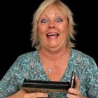 Stock Photo: Mature Blonde Womwith Cell Phone and Handgun (5)