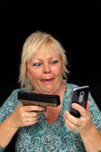 Mature Blonde Woman with Cell Phone and a Handgun (2) — Stock Photo
