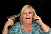 Mature Blonde Woman with Cell Phone and a Handgun (3) — Stock Photo
