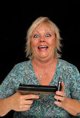 Mature Blonde Woman with Cell Phone and a Handgun (5) — Stock Photo