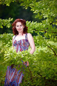 Woman with oak branches — Stock Photo