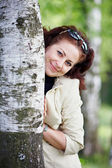 Woman with a birch — Stock Photo