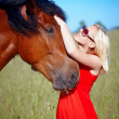 Girl and horse — Stock Photo #11313845