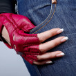 Female hand with manicure in a stylish glove — Stock Photo