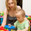 Baby And Mother Playing With The Toys — Stockfoto