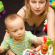 Baby And Mother Playing With The Toys — Stock Photo