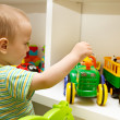Stock Photo: Baby Playing With Toys
