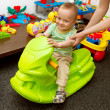 Stockfoto: Baby And Mother Playing With Toys