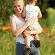Mother And Son Outdoors — Stock Photo #12371871