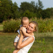 Mother And Son Outdoors — Stock Photo #12371987