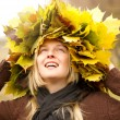 Woman with autumn wreath outdoors — Stock Photo #12372041