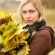 Woman with autumn wreath outdoors — Stock Photo #12372068