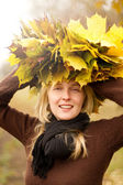 Woman with autumn wreath outdoors — Stock Photo