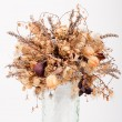Stock Photo: Dry flowers in glass vase