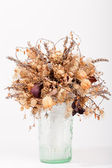 Dry flowers in a glass vase — Stock fotografie