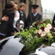 Beautiful bridal bouquet on car bonnet — Stock Photo