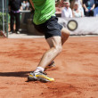 Stock Photo: Male tennis player lunging for ball