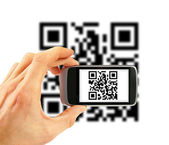 Hand with mobile phone scanning QR code — Stock Photo